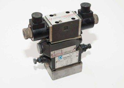 Conjunto electroválvula antirretorno pilotado y reguladora de caudal